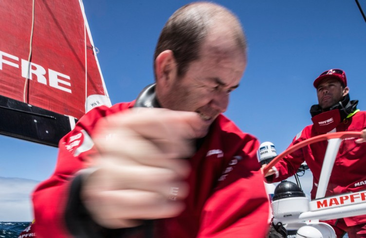 November 21, 2014. Leg 2 onboard MAPFRE. Jean Luc Nelias trimming the sails.